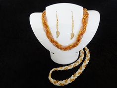 Braided gold and gold and white seed bead necklaces.