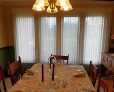 Sheer vertical blinds in a dining room. They look great in ANY room! Call Bellagio Window Fashions at 419-381-2700. #VerticalBlinds