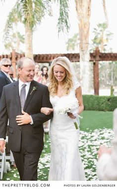 Bride walking with her father down the isle | Photographer: Laura Goldenberger