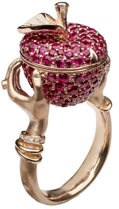 Stephen Webster poison apple ring in rose gold with rubies and diamonds. The apple opens to reveal a secret compartment