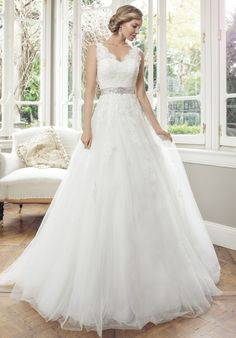 I love the back, the straps, the neck line, the belt shape color and sparkle, and the lace bleeding into the skirt from the bodice.  Mia Solano-M1415Z