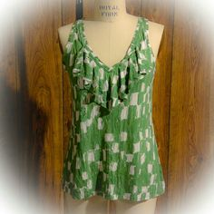 Summer Breezy Tank Top A soft knit top that can be dressed up or dressed down and you will be comfortable either way... A cheery kelly green/off-white print, ruffled front v neck. Rayon/Lyocell blend. Banana Republic Tops Tank Tops