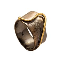 Contemporary black silver with gold detail wide fashion ring