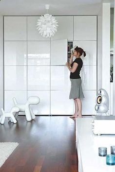 Ikea Besta units - I love the idea of a complete wall of units.Could be used in any room including a kitchen or playroom. The glossy finish reflects light back into the room and would hide a multitude of clutter. Great idea as they are not that deep and wouldnt take up much space. Placed floor to ceiling as shown makes it look built in and a lot more expensive than it actually is.