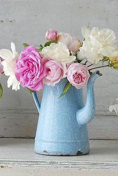 Vintage french blue enamel coffee pot filled with roses. This would look so great in my living room.