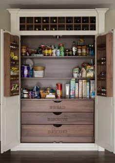 Don't you just love this built-in pantry with its labeled wood drawers? The wine rack at the top is a nice touch, too.