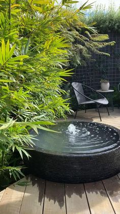 Our water bowl water feature in action nestled next to a beautiful green wall. Flowing to have a constant wet edge, the water flows over the edge and cycles back up through a pond hidden underneath the bowl. Timber decking surround for a modern contrast to the feature. Modern Water Feature, Water Packaging, Timber Deck, Water Flow, Decking, Water Features, Pond, Contrast, Action