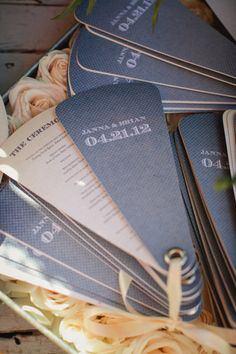 Having an outdoor wedding reception? Create wedding programs that are fans for guests to keep cool!