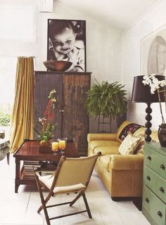 Love that couch. And that curtain. And the huge photo! (Okay, I love it all.)