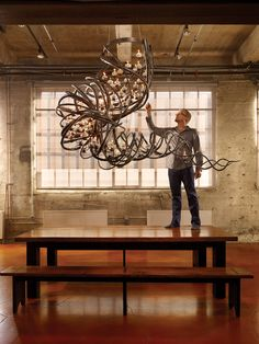 Oakland-based blacksmith Daniel Hopper created for a San Francisco home. Hopper is known for his innumerable nature-inspired candleholders at the James Beard Award-winning Slanted Door restaurant and other San Francisco hotspots. Now, the modern blacksmith has been offered a coveted space in SF showroom Coup D'Etat to hang an electrified version of that same steel chandelier.
