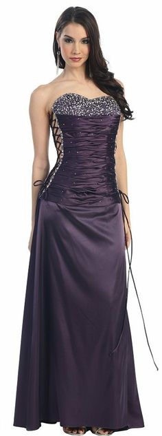 Below the bust, fabric is shirred with lace ups on both sides of the dress. Dress is floor length and shown in PLUM. Plum Prom Dresses, Designer Prom Dresses, Ball Dresses, Pretty Dresses, Formal Dresses, Beautiful Gowns, Beautiful Outfits, Silk Evening Gown, Pageant Gowns