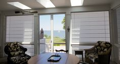 The Silica Silver Sunbrella® fabric, with its light flecks of grey give these custom Weather Queen Shades the classic beauty to complement this lovely ocean front home.