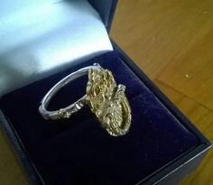 Check out this item in my Etsy shop https://www.etsy.com/uk/listing/177265044/kinetic-9ct-gold-silver-ring-inspired-by
