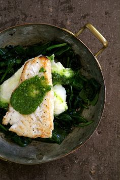 Cod with spinach pesto on a bed of spinach and mashed potatoes