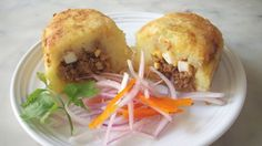 """Papa rellena..Papa rellena means """"stuffed potato"""", and it basically is mashed potato stuffed with minced beef, raisins, olives, and hard-boiled egg, and pan fried untill it's golden on the outside.  *be creative..choose your own filling..omit meat if desired"""