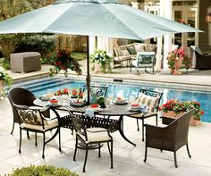 A big ole umbrella is a must in a poolside dining space.