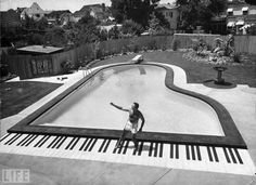 Forget that toy keyboard in Big; pianist Liberace has a full 88 keys to dance on at the grand piano-shaped pool in his California backyard in 1954. Description from pinterest.com. I searched for this on bing.com/images