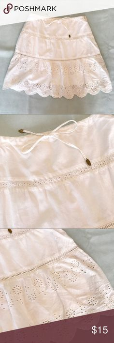 American Eagle White Skirt in size 0 American Eagle White Skirt with eyelet motif in size 0. Nice detailing. Great condition. American Eagle Outfitters Skirts Mini