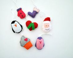 Set of 7 Felt Christmas ornaments. Christmas decorations. Handmade. Santa, cupcake, boot, heart, penguins...