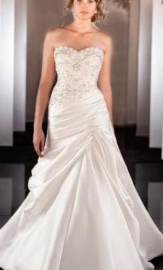 Martina Liana 467 12: buy this dress for a fraction of the salon price on PreOwnedWeddingDresses.com