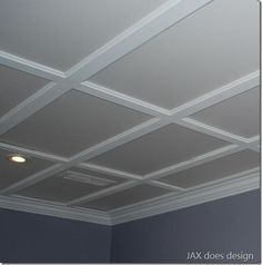 a drop ceiling that looks like a coffered ceiling.
