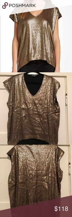 Michael Stars Gold Sequin High-Low Top Size M Michael Stars Gold Sequin High-Low Top Size Medium but fits more like a Large or XL. Just depends on how you want it to hang. This top has never been worn and always had the tag still on it but it seems to have fallen off and lost in my zoo of a closet. Brand new, never worn. Michael Stars Tops Tunics