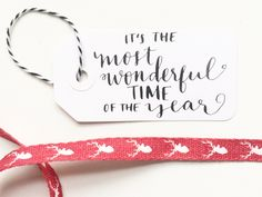 Most Wonderful Time of the Year gift tag in modern calligraphy by M.B. Calligraphy can be found on www.mbcalligraphy.com