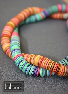 Polymer clay disc necklace -- reminds me of puka bead shell ones. No instructions, but it looks like you would just roll out the clay very thin, stamp/cut small circles, and poke a hole in the center for threading.