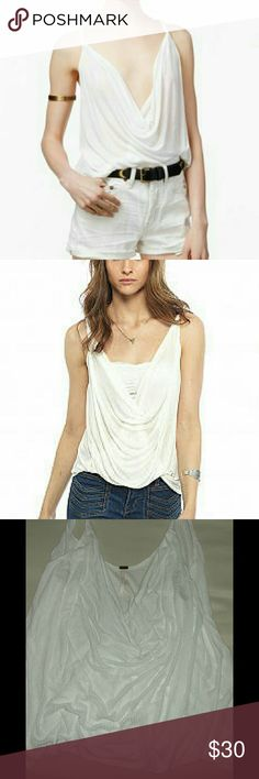 LIKE NEW FREE PEOPLE IVORY TOP Super cute top from Free People!! In perfect condition! I wore it once last fall. It's been hanging in my office since. It's too big for me now. Size large. No signs of wear at all! In new condition!! Free People Tops