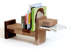 """Pack of dogs. This funny looking bookshelf tends more towards play and joy than functionality but I like the design and I can't agree more that this """"pack of dogs"""" will keep my books safe and probably exactly where I left them."""