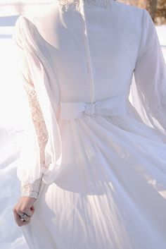 Flowing Vintage Wedding Dress with Lace Sleeves | Nicole Colwell Photography | A Dream of Spring - Vintage Floral Wedding in the Snow