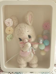 Cute needle felted bunny. I like his sweet pose and the props around him really makes him ever cuter.