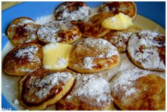 Poffertjes. this is typical dutch. A sort of mini pancakes made in a special pan. you eat them with butter and powder sugar.