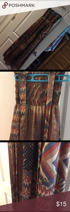 Maxi dress by Just Ginger Brown patterned maxi dress by Just Ginger. Straps for a halter tie behind the neck. Nice silky and flowy material! Fully lined. 100% polyester. Size small. Just Ginger Dresses Maxi