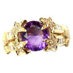 Amethyst Diamond Gold Ring   Yellow gold ring adorned with an amethyst, star-studded with diamonds cut in brilliant and diamonds carved in a baguette. 15.5 grs. From a unique collection of vintage band rings at https://www.1stdibs.com/jewelry/rings/band-rings/