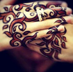 Two coloured henna abstract designs
