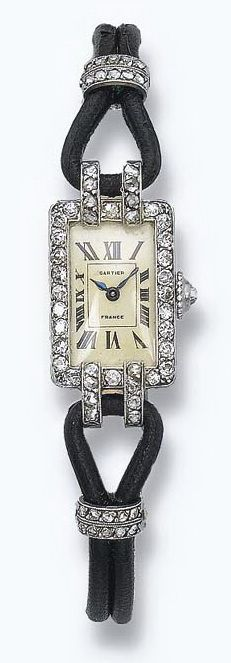 AN ART DECO LADY'S WRISTWATCH, BY CARTIER  The cream-coloured rectangular-shaped dial with Roman numerals within a single-cut diamond surround to the black leather double-string bracelet and black enamel deployant buckle, circa 1925, case 1.3 cm wide, with French assay marks for platinum and gold