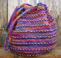 Free knitting pattern for Exploring Stripes Bag - Holly Webb designed this multi-color beaded bag that is around and tall Tasche Variegated Yarn Knitting Patterns
