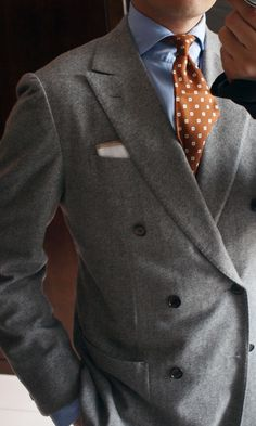 George from Beijing in a beautiful gray flannel double-breasted suit. Flannel has a wonderful combination of softness and weight that makes it perfect for men's suits. The way it falls and moves are unparalleled. The suit is bespoke, from Naples. Look at the lovely shoulders, and the high armholes. Notice that while the suit is double-breasted, it also has a wonderful shape, with a lovely waist and a slim, height-accentuating form. And what you can't see is that George is wearing choco...