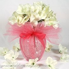 Scalloped-edge tulle fabric circles wrapped around a small vase and tied with a coordinating ribbon.  An easy way to decorate a plain vase - 15 inch diameter tulle circles. Event supplies & decorations - www.yourweddingcompany.com