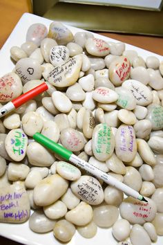 "AWESOME ""guest book"" idea!  Have all of your guests sign/write message on a stone!  After the wedding you can keep all of the stones in a vase or jar for display"