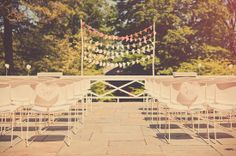 30 Unique Altar Alternatives For Outdoor Weddings: Bring a bit of personality to your ceremony with bright, punchy garland and big, oversize balloons.  Source  : Delve into the popular ombre trend with layers of colored bunting in a variety of shades — simple, festive, and totally original.  Source