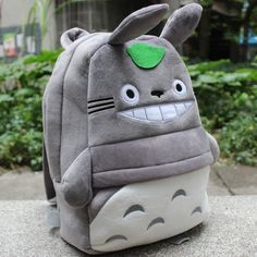 "This adorable backpack is a must-have for all Totora fans.  Soft plush. 13"" x 10"" Please allow 3-4 weeks for shipping."