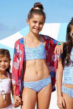 A striped reversible girls tankini in blue and white stripe on one side and a tropical print on the other by Seafolly. Little Girl Bikini, Little Girl Swimsuits, Baby Girl Swimsuit, Bikini Girls, Preteen Girls Fashion, Young Girl Fashion, Little Girl Fashion, Cheer Picture Poses, Fashion Clothes