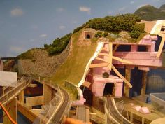 model train mountain scenary | Cardboard strips were attached to the wire & risers and woven in the ...