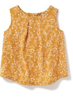 love this top from Old Navy. Every color is adorable but the mustard and navy prints are my fav.