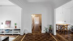 Portuguese studio Aboim Inglez Arquitectos has updated this 1930s apartment in Lisbon with patterned parquet floors, grey marble surfaces, custom furniture and a new sun room.