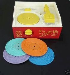 My first record player.  W  A  Y  before 8 tracks, cassettes, or CDs.  Nevermind downloads!!