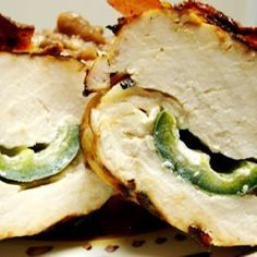 stuffed jalapeno peppers are wrapped in marinated chicken breasts. tasty bacon seals the deal!