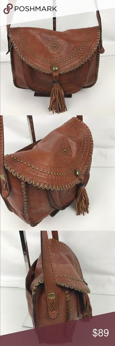 """Patricia Nash Beaumont Flap Shoulder Bag Authentic. Worn Leather. Used - Good Condition Inside and Out.  Beautifully crafted with a well-worn artisan feel, this stunning flap crossbody with divided interior offers the best of both trends with bohemian and Western-style tooling plus whipstitch detail. A swishy tassel finishes the look. 10-3/4""""W x 7-1/2""""H x 3-1/2""""D. 0""""-23""""L adjustable crossbody strap. RB800  Thank you for your interest!  PLEASE - NO TRADES / NO LOW BALL OFFERS / NO OFFERS IN…"""